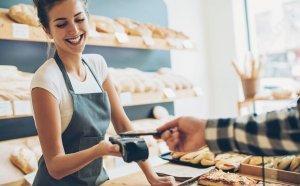 small business owner using a credit card processing app