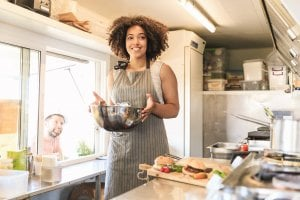 Small restaurant business owner benefiting from a business loan
